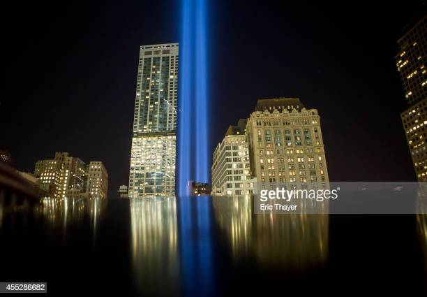 The 'Tribute in Light' is reflected on the 9/11 Memorial on September 11 2014 in New York City This year marks the 13th anniversary of the September...