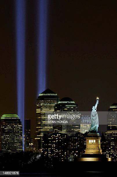 The 'Tribute in Light' memorial consisting of two shafts of light to represent the World Trade Center Twin Towers is lit 11 March in New York on the...