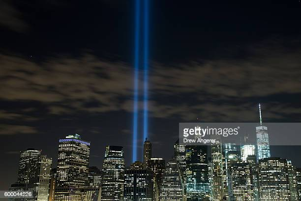 The 'Tribute in Light' rises from the Lower Manhattan skyline as seen from the Brooklyn Heights Promenade September 7 2016 in the Brooklyn borough of...