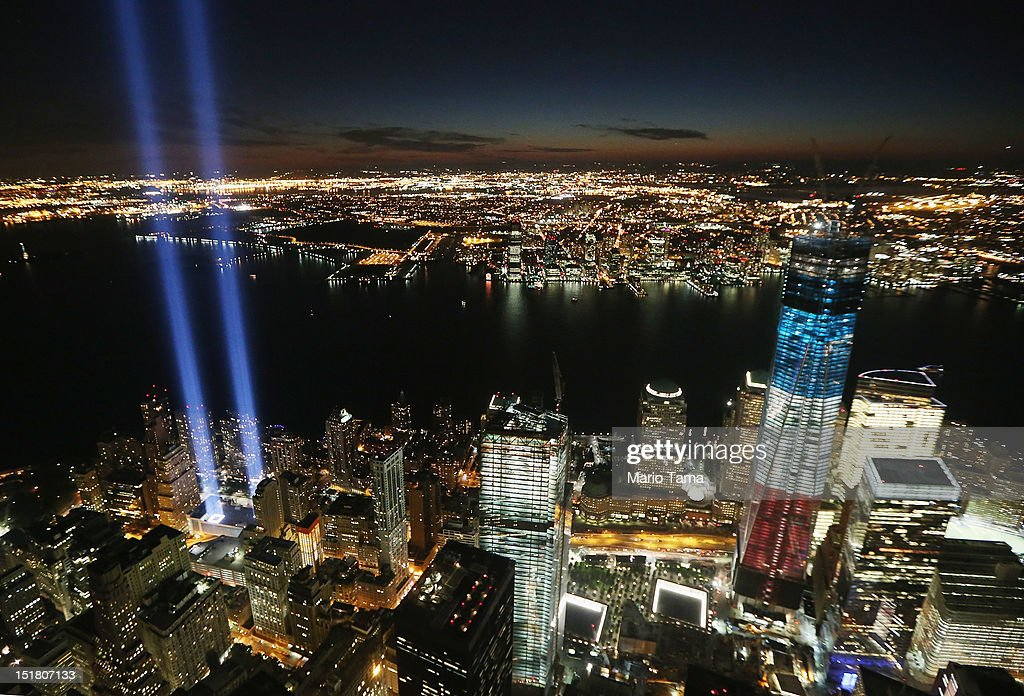 The 'Tribute in Light' shines as One World Trade Center (R) rises under construction on the eleventh anniversary of the terrorist attacks on lower Manhattan at the World Trade Center on September 11, 2012 in New York City. New York City and the nation are commemorating the eleventh anniversary of the September 11, 2001 attacks which resulted in the deaths of nearly 3,000 people after two hijacked planes crashed into the World Trade Center, one into the Pentagon in Arlington, Virginia and one crash landed in Shanksville, Pennsylvania.