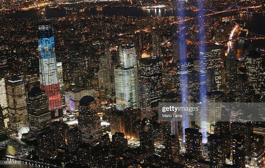 The 'Tribute in Light' shines as One World Trade Center (L) rises under construction on the eleventh anniversary of the terrorist attacks on lower Manhattan at the World Trade Center on September 11, 2012 in New York City. New York City and the nation are commemorating the eleventh anniversary of the September 11, 2001 attacks which resulted in the deaths of nearly 3,000 people after two hijacked planes crashed into the World Trade Center, one into the Pentagon in Arlington, Virginia and one crash landed in Shanksville, Pennsylvania.