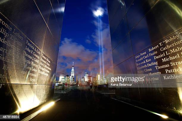The Tribute in Light shines over the New York skyline from inside the Liberty State park 9/11 memorial on September 11 2015 in Jersey City New Jersey...