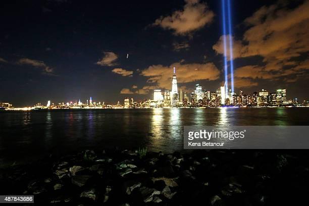 The Tribute in Light shines over the New York Skyline on September 11 2015 in Jersey City New Jersey Today marks the fourteenth anniversary of the...