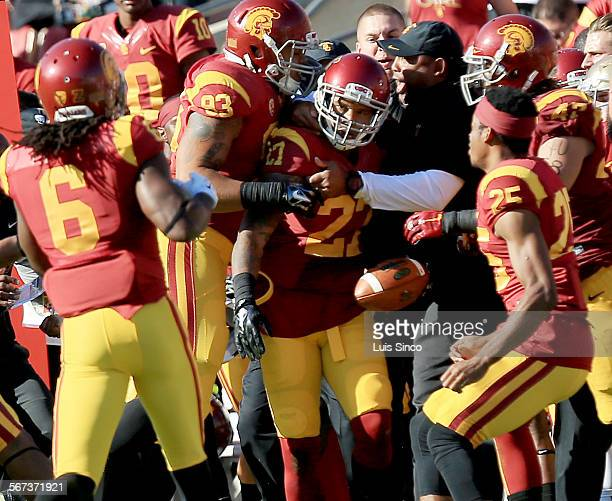 LOS ANGELES CALIF NOV 29 2014 The Trojans bench swarms around free safety Gerald Bowman after he intercepted a pass by Notre Dame quarterback Everett...