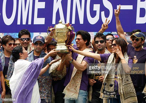 The trophy is lifted by Cheif Minister of West Bengal Mamta Banerjee Kolkata Knight Riders Captain Gautam Gambhir Bollywood actors and owners...