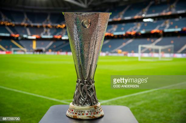 TOPSHOT The trophy is on display next to the pitch at the Friends Arena in Solna outside Stockholm on May 23 on the eve of the UEFA Europa League...