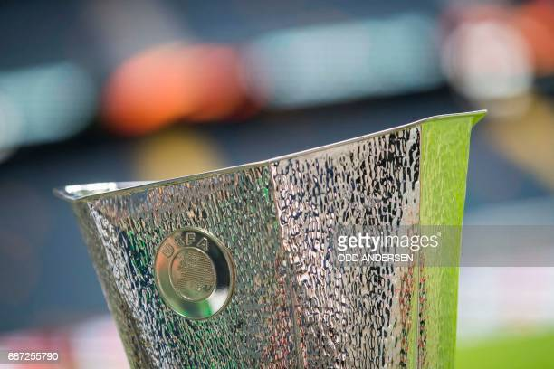 The trophy is on display next to the pitch at the Friends Arena in Solna outside Stockholm on May 23 on the eve of the UEFA Europa League football...