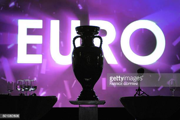 The trophy of the UEFA football championships is seen in front of a screen during a press briefing '100 Days to Go' before the Euro 2008 football...