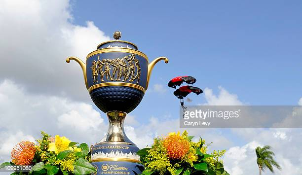 The trophy sits on display in front of a member of the United States Army Special Operations Command 'Black Knights' parachuting in during Military...