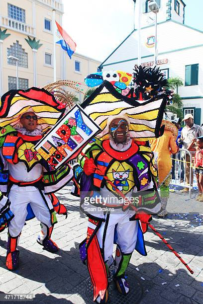 The troupe Estreno di Pikete parade in colorful costumes inspired by Brazilian neopop artist Romero Britto while performing on Front Street during...