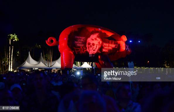 The Trump pig floats over the crowd during Roger Waters performance at Desert Trip at The Empire Polo Club on October 16 2016 in Indio California