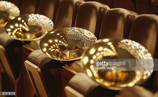 The trumpets of a military band rest on chairs before the closing session of the Chinese People's Political Consultative Conference at the Great Hall...