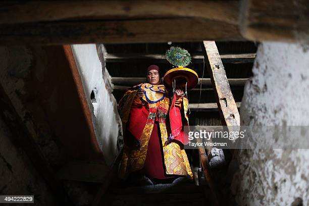 The tsowo lead monk during the festival descends the stairs of the former King's palace before a ceremonial dance during the Tenchi Festival on May...