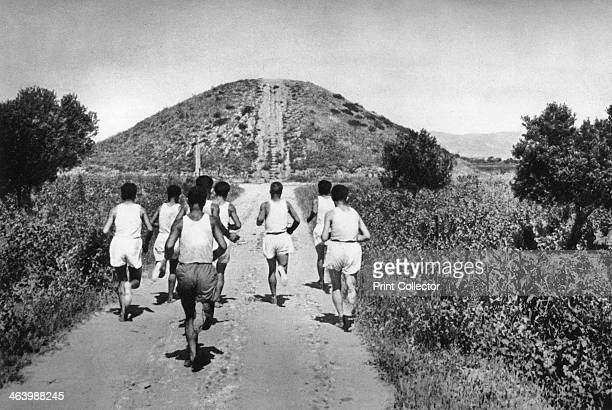 The Tumulus of Marathon Greece 1937 Runners in front of the burial mound of the 192 Athenian dead at the site of the battle of Marathon in 490 BC...