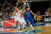 The tunisian forward Hamdi Braa defends against a drive to the basket by The italian power forward Danilo Gallinari in the match between Italy and...