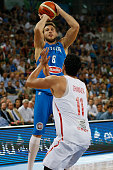 The tunisian power forward Mohamed Mokthar Ghyaza defends against a drive to the basket by The italian power forward Danilo Gallinari in the match...