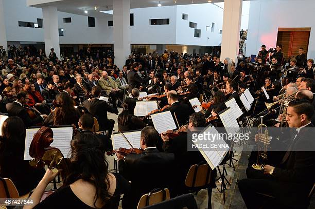 The Tunisian Symphony Orchestra performs at the National Bardo Museum in Tunis on March 24 during an official ceremony honouring the 21 people killed...