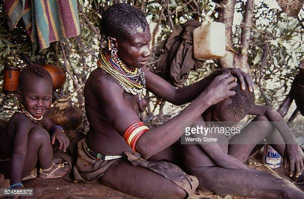 The Turkana a nomadic pastoral Nilotic people live in the harsh semiarid desert and raise camels sheep and goats for their survival The Turkana rely...