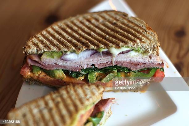 The Turkathon sandwich turkey bacon spinach tomatoes red onion green pepper swiss cheese avocados and chipotle at Farmer Horse Coffee