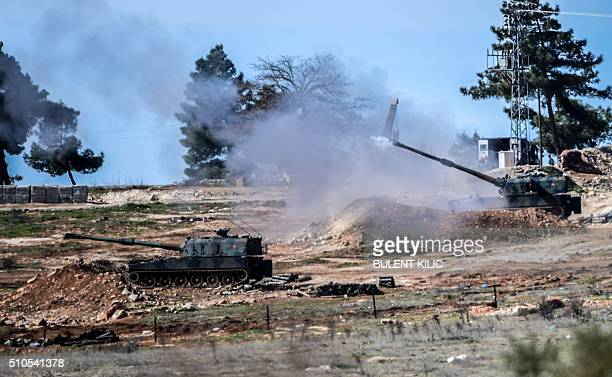 The Turkish army tanks stationed near the Oncupinar crossing gate near the town of Kilis south central Turkey fire towards the Syria border on...