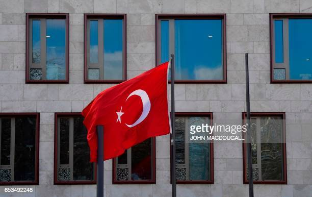 The Turkish flag flies in front of the Turkish embassy in Berlin on March 15 2017 Turkey has been waging a war of words with its NATO partner Germany...