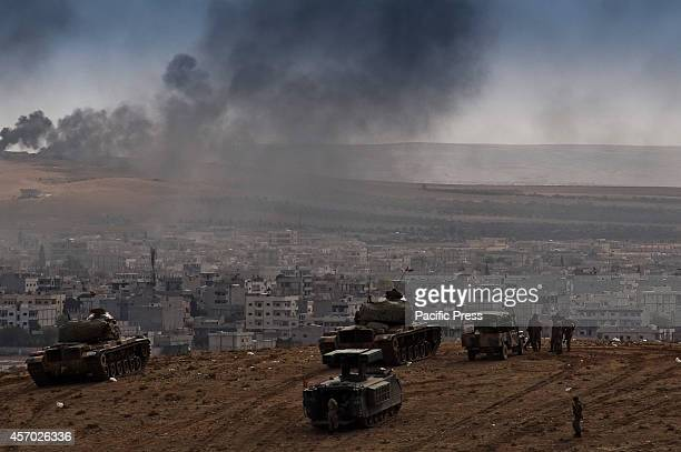 The Turkish military troops watching the onslaught battle as the US and coalition forces make airstrikes on the key positions of ISIS allowing the...