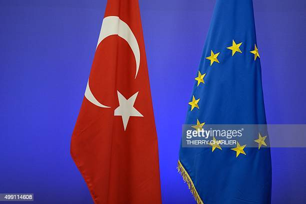 The Turkish national flag and the EU flag are pictured ahead of a summit on relations between the European Union and Turkey and on managing the...