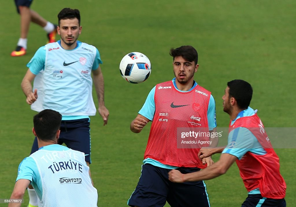 The Turkish national football team's Ozan Tufan (C) in action as he takes part in a training session at the Gloria Sports Arena during the camp for their Euro 2016 preparations in Belek district of Antalya, Turkey on May 27, 2016.