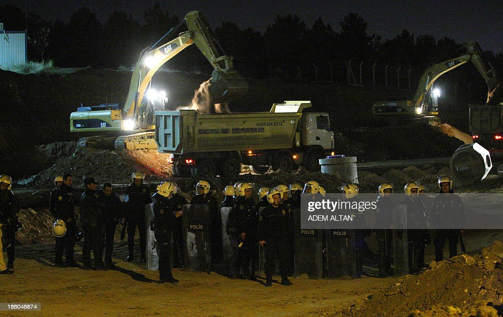 The Turkish riot police stand guard during a protest against the clearance of trees to make way for a controversial road development on October 27, 2013 outside the Middle East Technical University (METU) in Ankara.