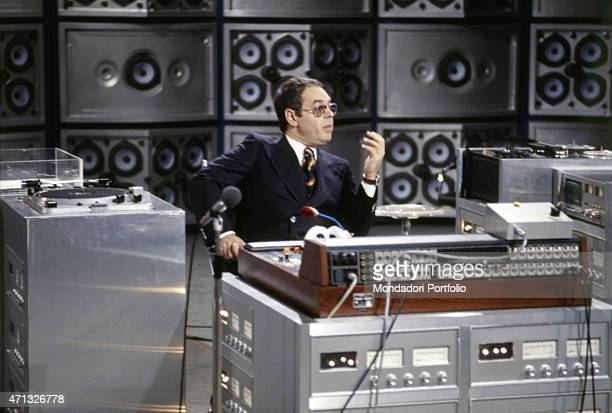 The TV author Gianni Boncompagni sitting in the studios of the music TV show Discoring 1978