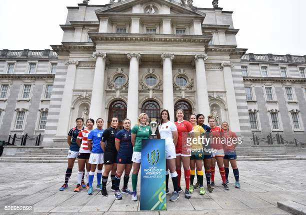 The twelve captains of the countries competing in the Womens Rugby World Cup pose with the trophy during a photocall at Goverment Buildings on August...
