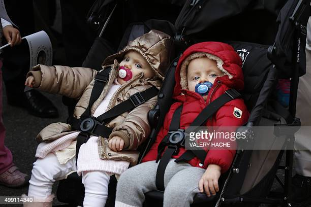 The twin children of the Prince and Princess of Monaco Prince Jacques and Princess Gabriella are pictured as their parents take part in a 'March for...