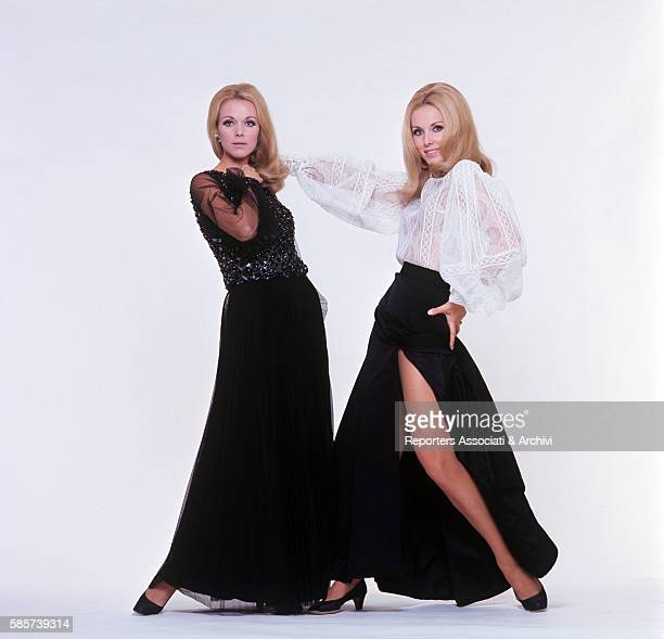 The twin sisters and famous German variety showgirls Alice and Ellen Kessler posing in a studio wearing different clothes They knew the celebrity...