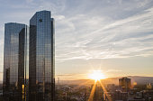 The twin tower skyscraper headquarter offices of Deutsche Bank AG stand as the sunsets in Frankfurt Germany on Monday July 25 2016 Deutsche Bank...