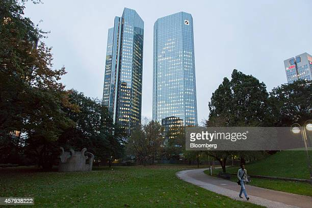 The twin tower skyscraper headquarters of Deutsche Bank AG stand beside a park in Frankfurt Germany on Friday Oct 24 2014 The cost for banks to...