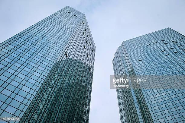The twin towers of the Deutsche Bank AG headquarters stand in Frankfurt Germany on Thursday Oct 29 2015 Deutsche Bank AG said it will shrink the...