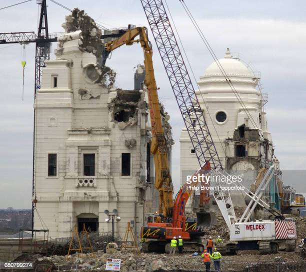 The Twin Towers of the old Wembley Stadium in London are knocked down on the 8th February 2003