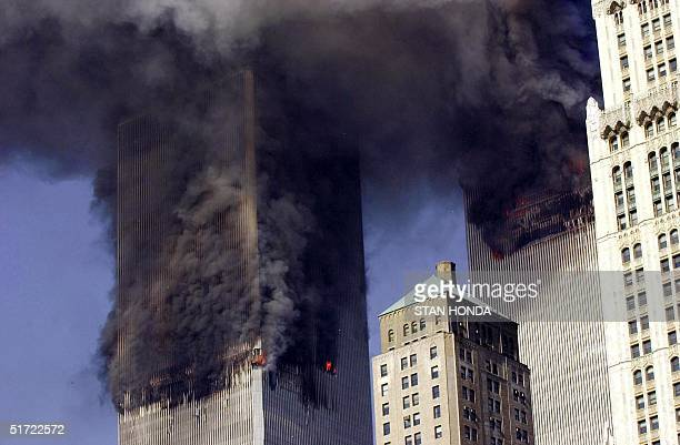 The twin towers of World Trade Center burn after two planes crashed into each building 11 September in New York The suspected terrorist attacks...