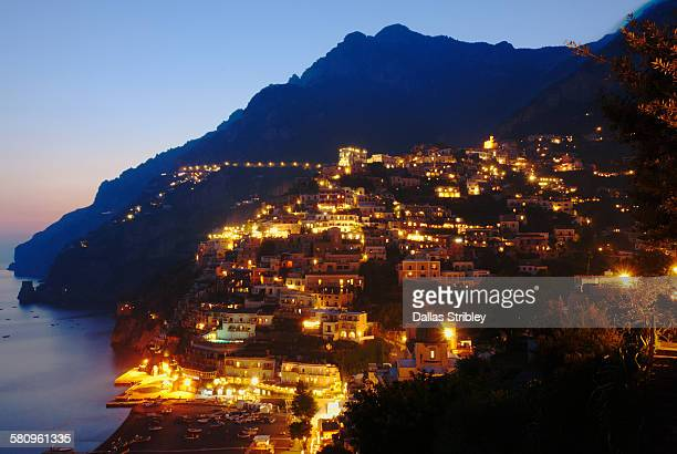 The twinkling lights of Positano, at twilight