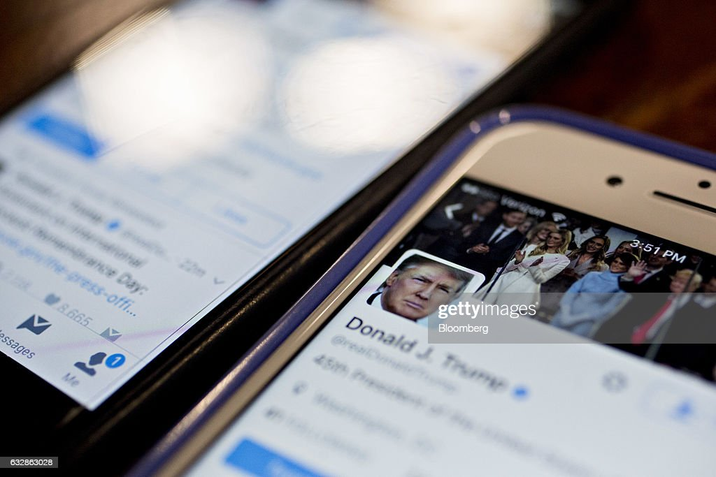 The Twitter Inc. account of U.S. President Donald Trump, @realDoanldTrump, is seen on an Apple Inc. iPhone arranged for a photograph in Washington, D.C., U.S., on Friday, Jan. 27, 2017. Mexican President Enrique Pena Nieto canceled a visit to the White House planned for next week after Trump on Thursday reinforced his demand, via Twitter, that Mexico pay for a barrier along the U.S. southern border to stem illegal immigration. Photographer: Andrew Harrer/Bloomberg via Getty Images