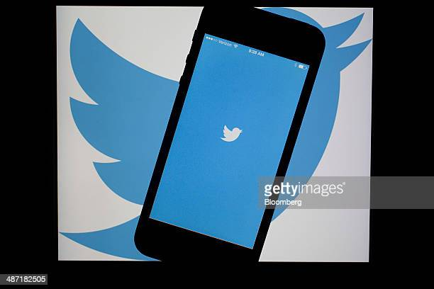 The Twitter Inc application and logo are displayed on an Apple Inc iPhone 5s and iPad Air in this arranged photograph in Washington DC US on Friday...