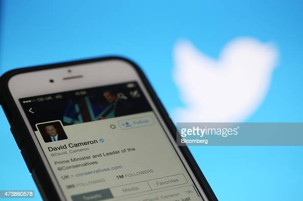 The Twitter Inc feed of David Cameron UK prime minister and leader of the Conservative Party is displayed on the screen of an Apple Inc iPhone 6 in...