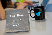 The Twitter Inc logo is displayed as an employee works the company's headquarters in San Francisco California US on Friday Sept 19 2014 Twitter Inc...