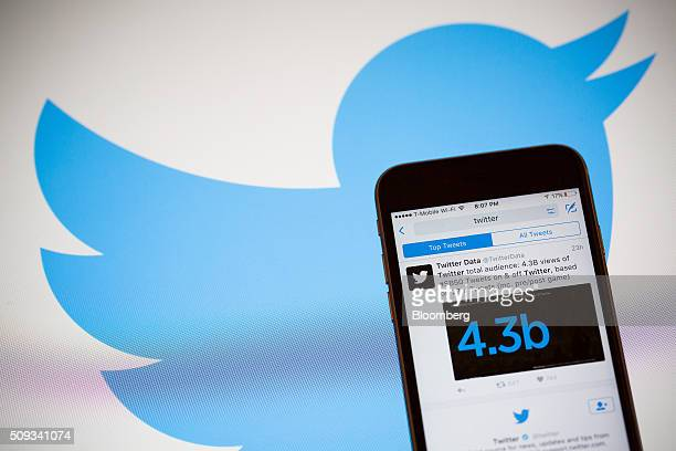 The Twitter Inc logo is seen behind an Apple Inc iPhone 6s displaying the company's mobile application in this arranged photograph taken in New York...