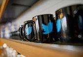 The Twitter Inc logo is seen on coffee mugs inside the company's headquarters in San Francisco California US on Friday Sept 19 2014 Twitter Inc...
