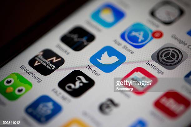 The Twitter Inc mobile application icon is displayed on the screen of an Apple Inc iPhone 6s in this arranged photograph taken in New York US on...