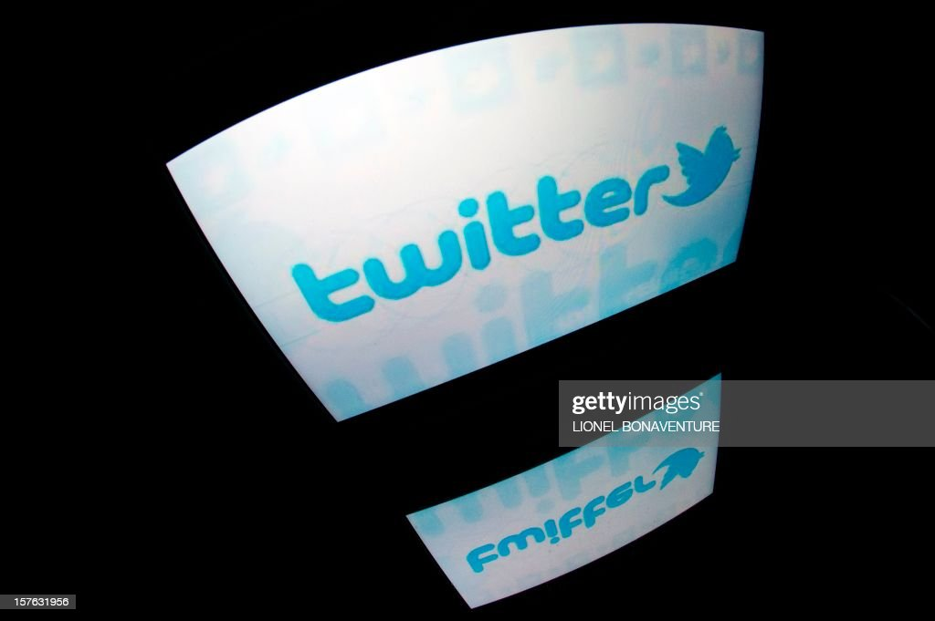The 'Twitter' logo is seen on a tablet screen on December 4, 2012 in Paris.