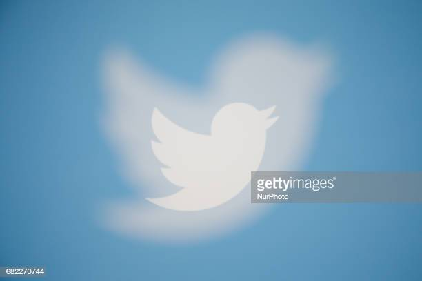 The Twitter logo is seen on various devices produced with an in camera multiple exposure The company reported that in the first quarter of 2017 its...