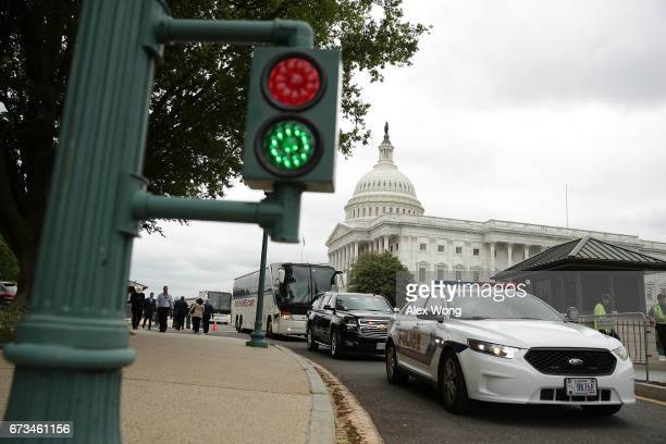 The two buses with Senate members aboard escorted by the U S Capitol Police vehicles leave the Capitol for the White House April 26 2017 in...