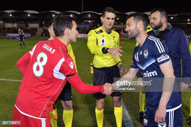 The two captains Isaas Sanchez of United and Carl Valeri of the Victory shake hands at the coin toss prior to the round of 16 FFA Cup match between...